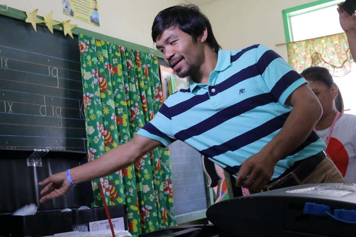 Filipino boxing champion and senate candidate Manny Pacquiao throws his receipt after casting his vote in Kiamba, Sarangani province, Philippines, on May 9, 2016.