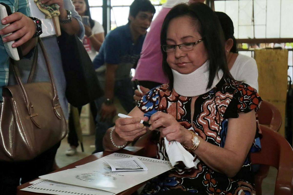 Former Philippine President Gloria Macapagal Arroyo, detained on corruption charges, is granted furlough from hospital arrest to vote in Lubao, Manila, on May 9, 2016.