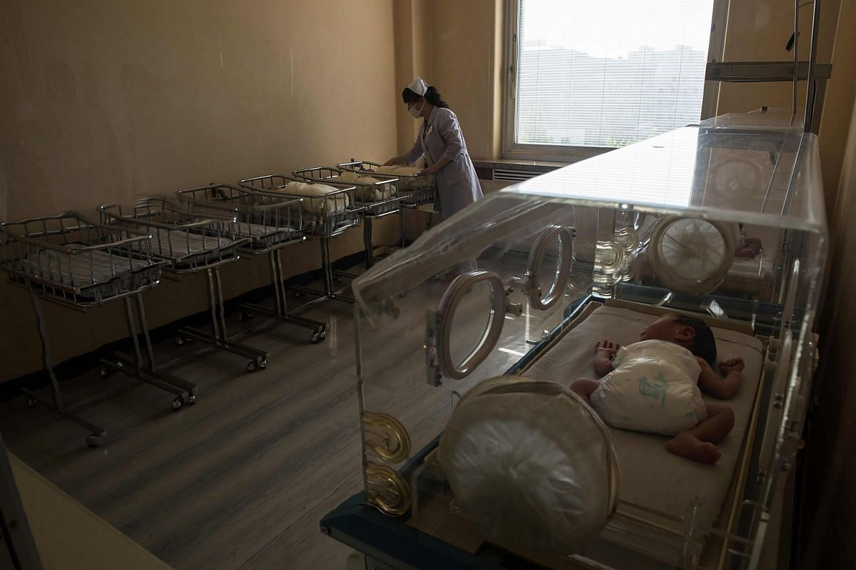A nurse tends to new-born infants in a ward at the Pyongyang Maternity Hospital during a government-organised media tour in Pyongyang.