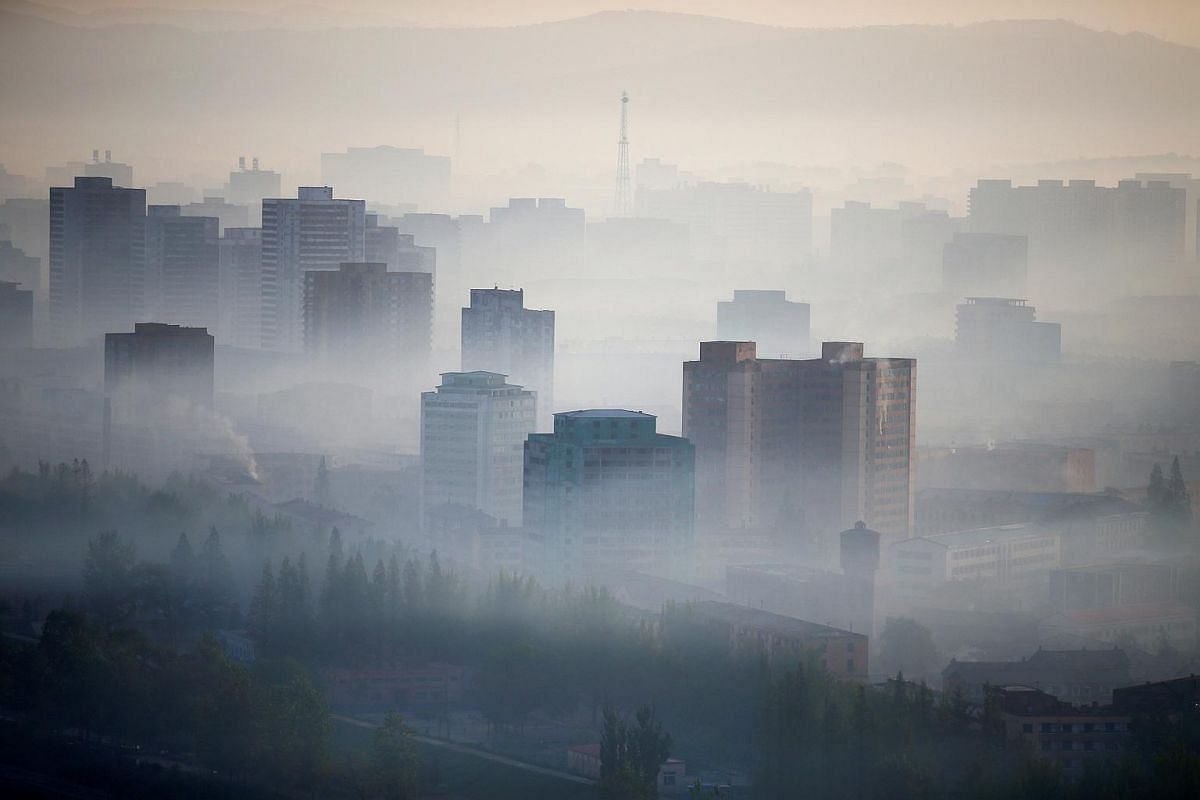 Morning fog blankets central Pyongyang on May 7, 2016.