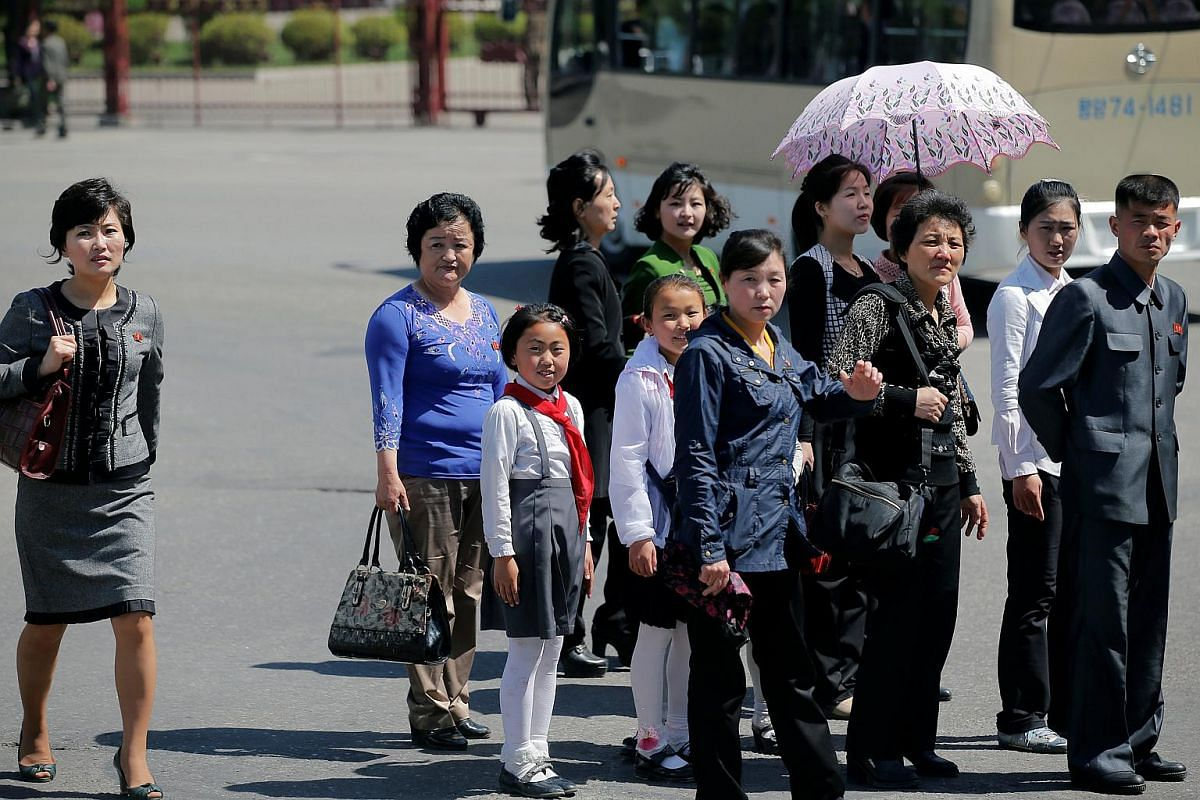 People cross the street in central Pyongyang.