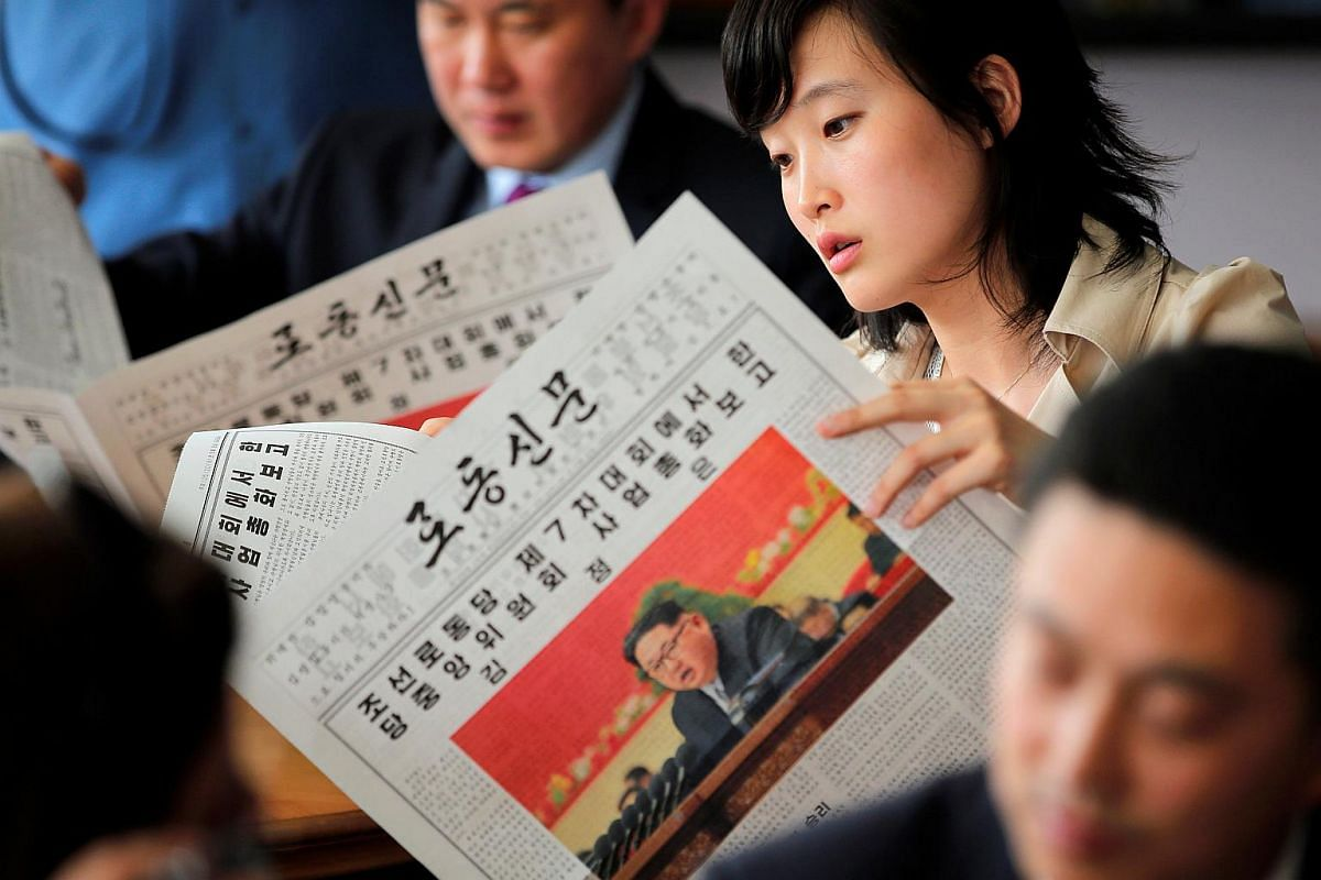 Foreign reporters and their government guides follow, in newspapers and on television, the address by North Korean leader Kim Jong Un to the Workers' Party of Korea (WPK) congress.