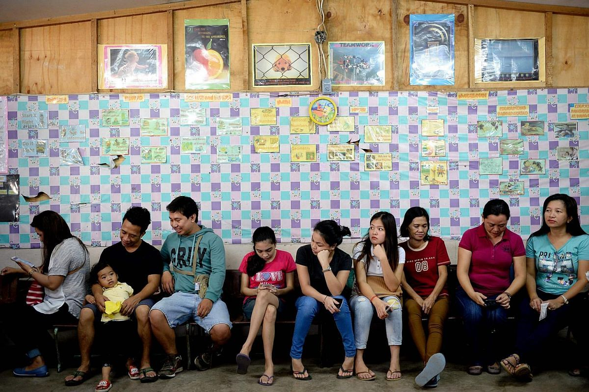 Residents wait for their turn to vote in the presidential election at a polling station in Davao, on the southern island of Mindanao.