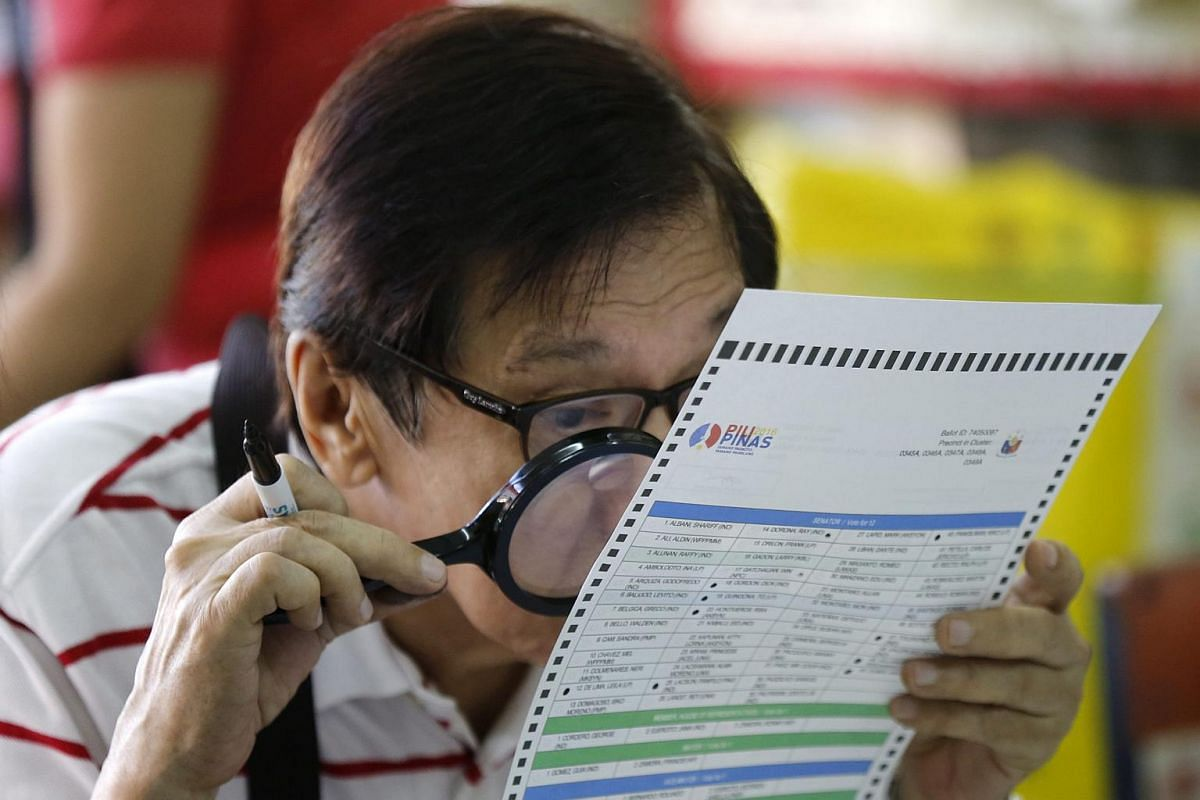 A Filipino man casts his vote during in San Juan city, Manila, on May 9, 2016.