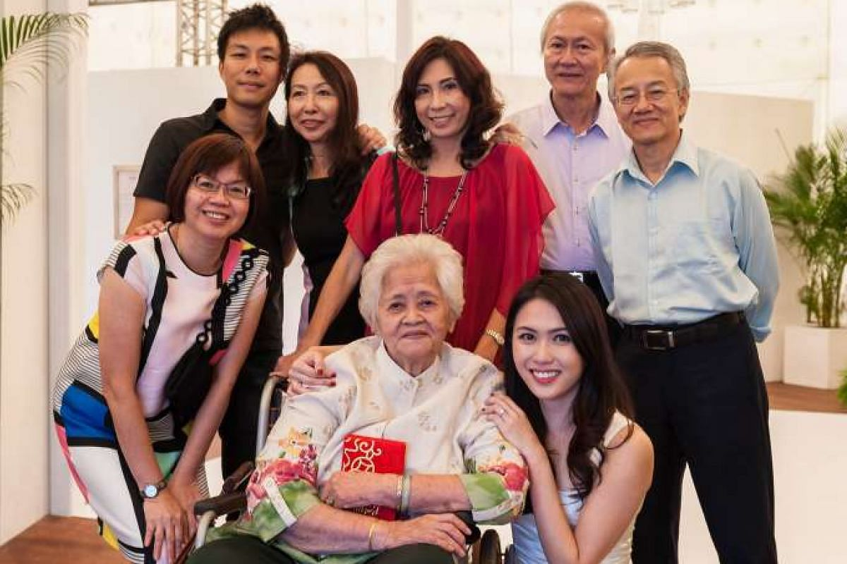 My life so far: Mr Chen (left) and his wife, Ms Mandy Chew (bottom right), with their families.