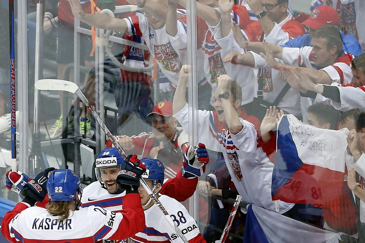 Tomas Plekanec (centre) of the Czech Republic celebrates with his teammates after scoring during the Ice Hockey World Championship 2016 preliminary round match between the Czech Republic and Latvia at the Ice Palace in Moscow, Russia, on May 7, 2016.