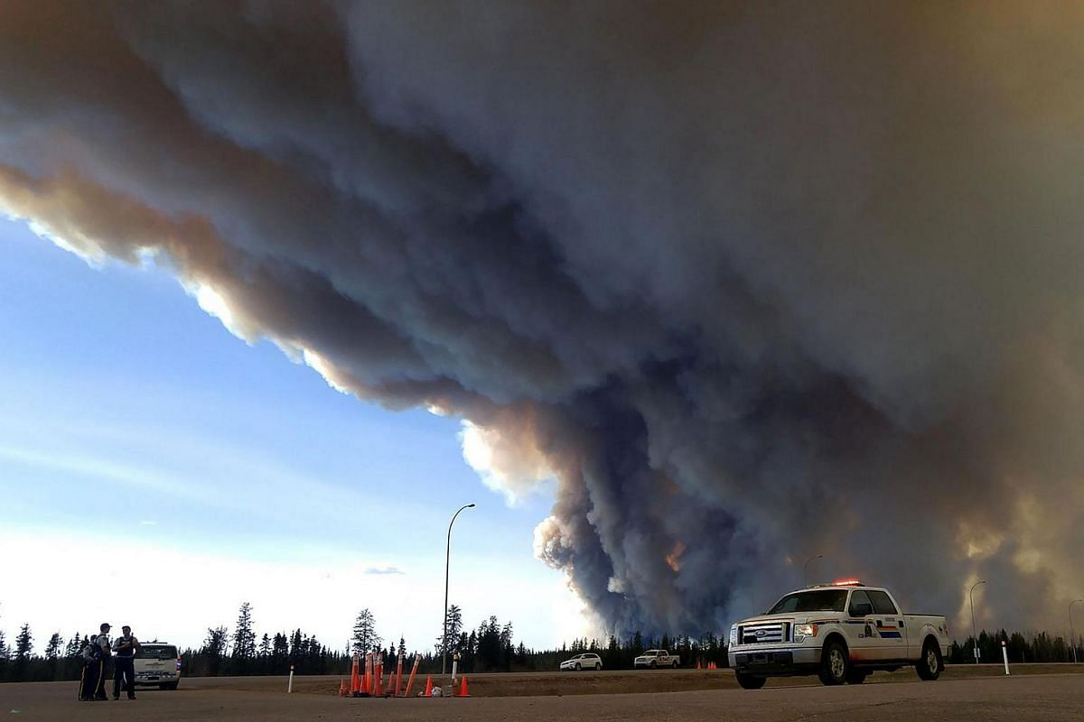 In this image released by the Alberta Royal Canadian Mounted Police (RCMP), members of the RCMP monitor the Fort McMurray Wildfire, on May 7, 2016 in Fort McMurray, Canada.