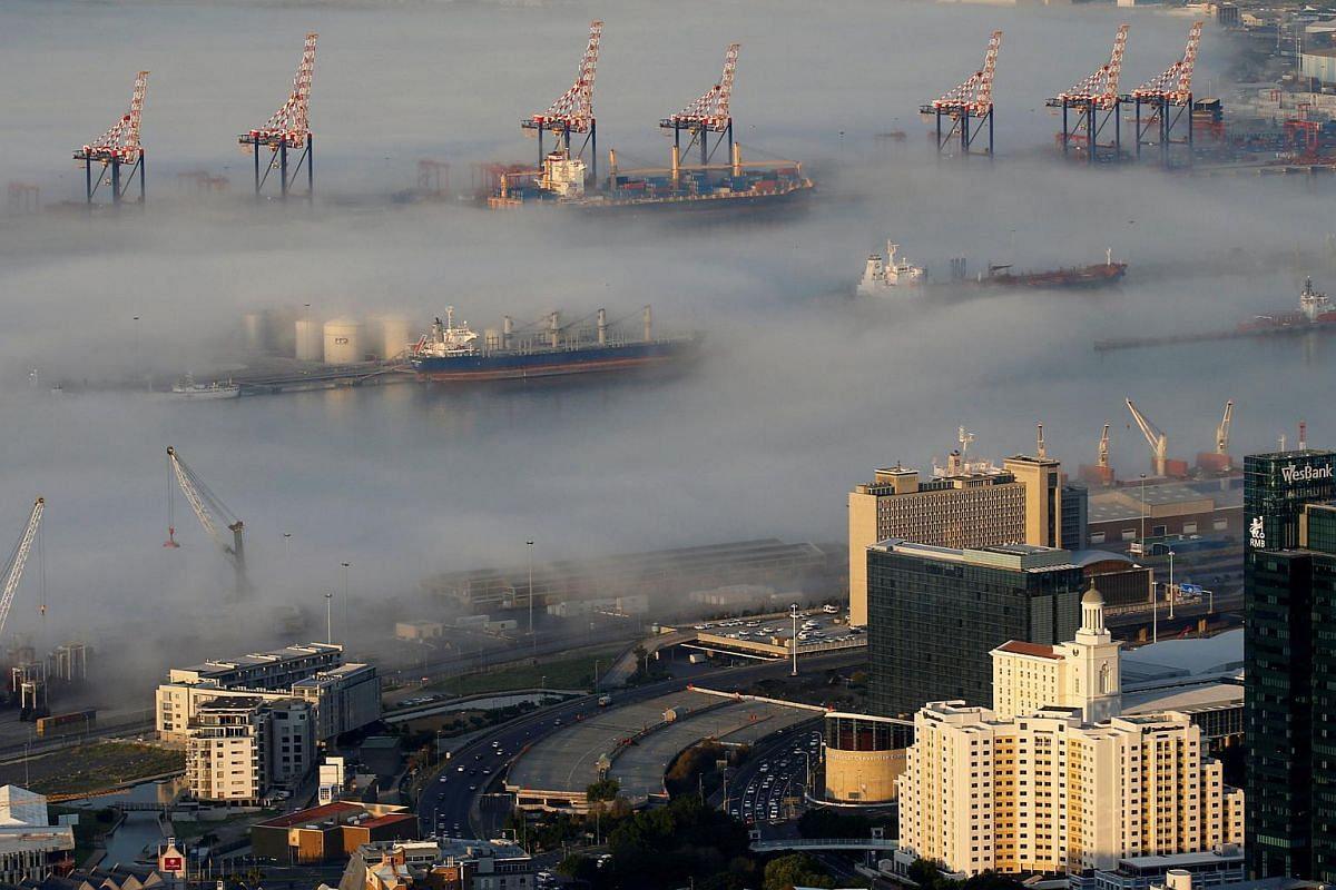 Seasonal fog enshrouds ships docked in Cape Town harbour, South Africa, on May 8, 2016.