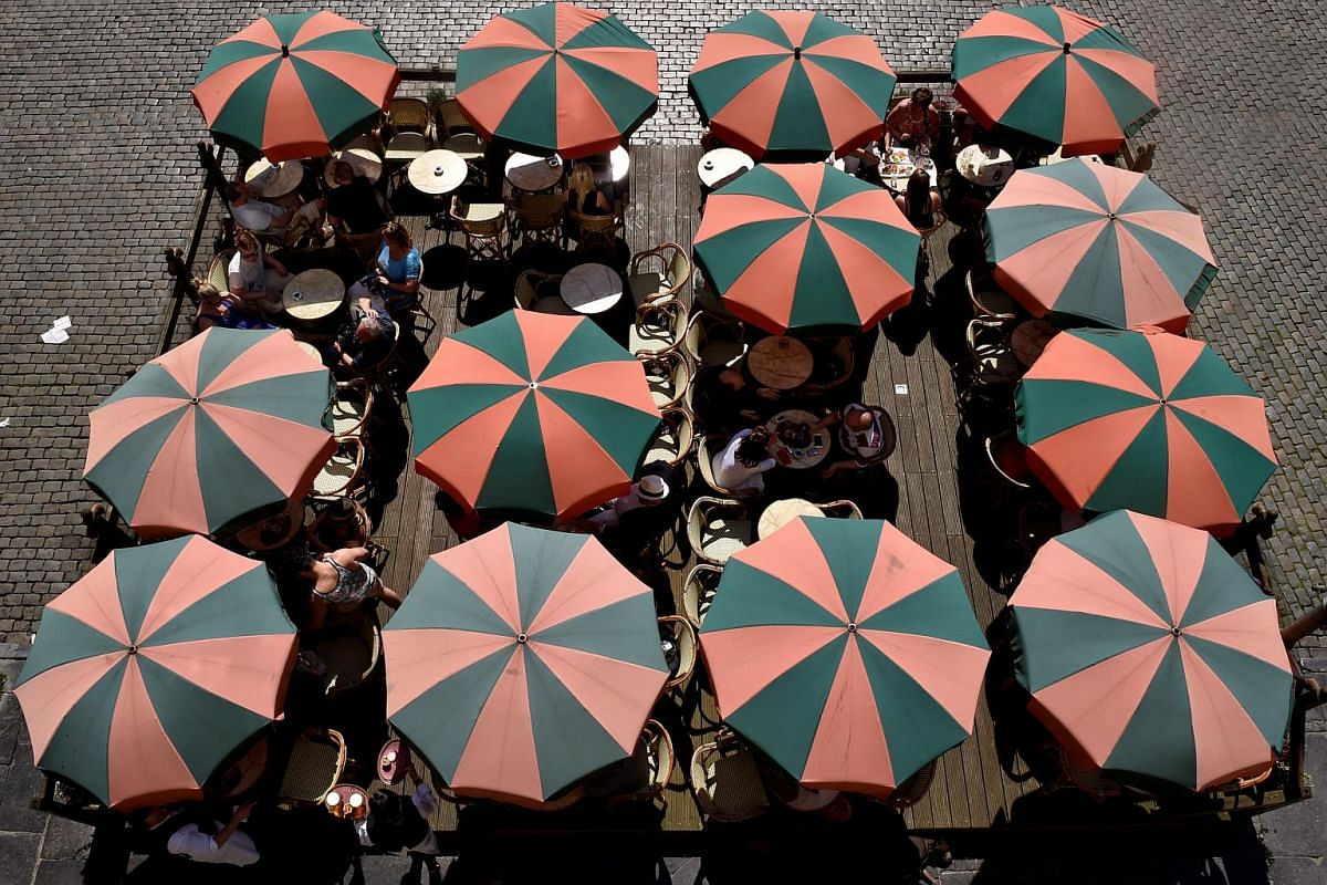 Terrace umbrellas are displayed during a hot and sunny day at the Grand Place in Brussels, Belgium, on May 8, 2016.