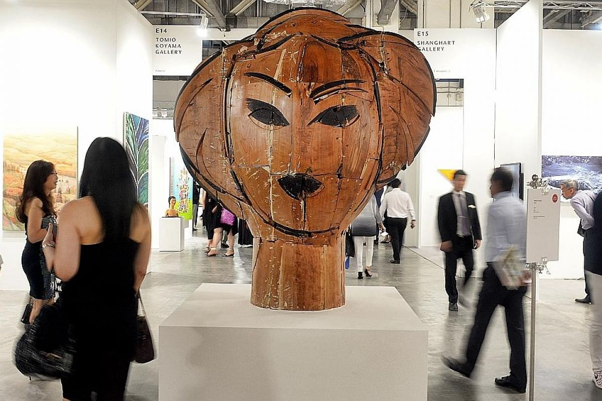 A wood sculpture, Dorothy, by Spanish artist Manolo Valdes, on display at Art Stage Singapore held in January. The art fair is launching a Jakarta edition to connect the Singapore art market to the region.