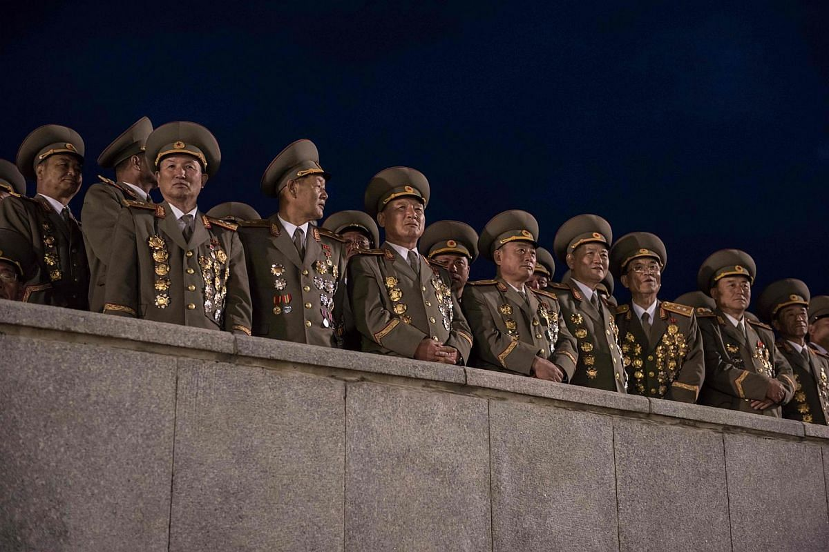 Military officers attend a torchlight parade on Kim Il-Sung square during festivities marking the end of the 7th Workers Party Congress in Kim Il-Sung square in Pyongyang on May 10, 2016.