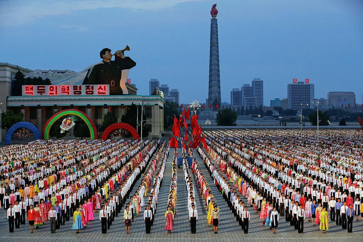 People participate in a mass dance in the capital's main ceremonial square in Pyongyang, North Korea, on May 10, 2016.
