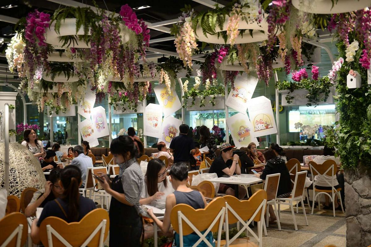 Flowers and Hello Kitty themed decorations are seen in the interior of the Hello Kitty cafe at Changi Airport Terminal 3, on May 12, 2016.