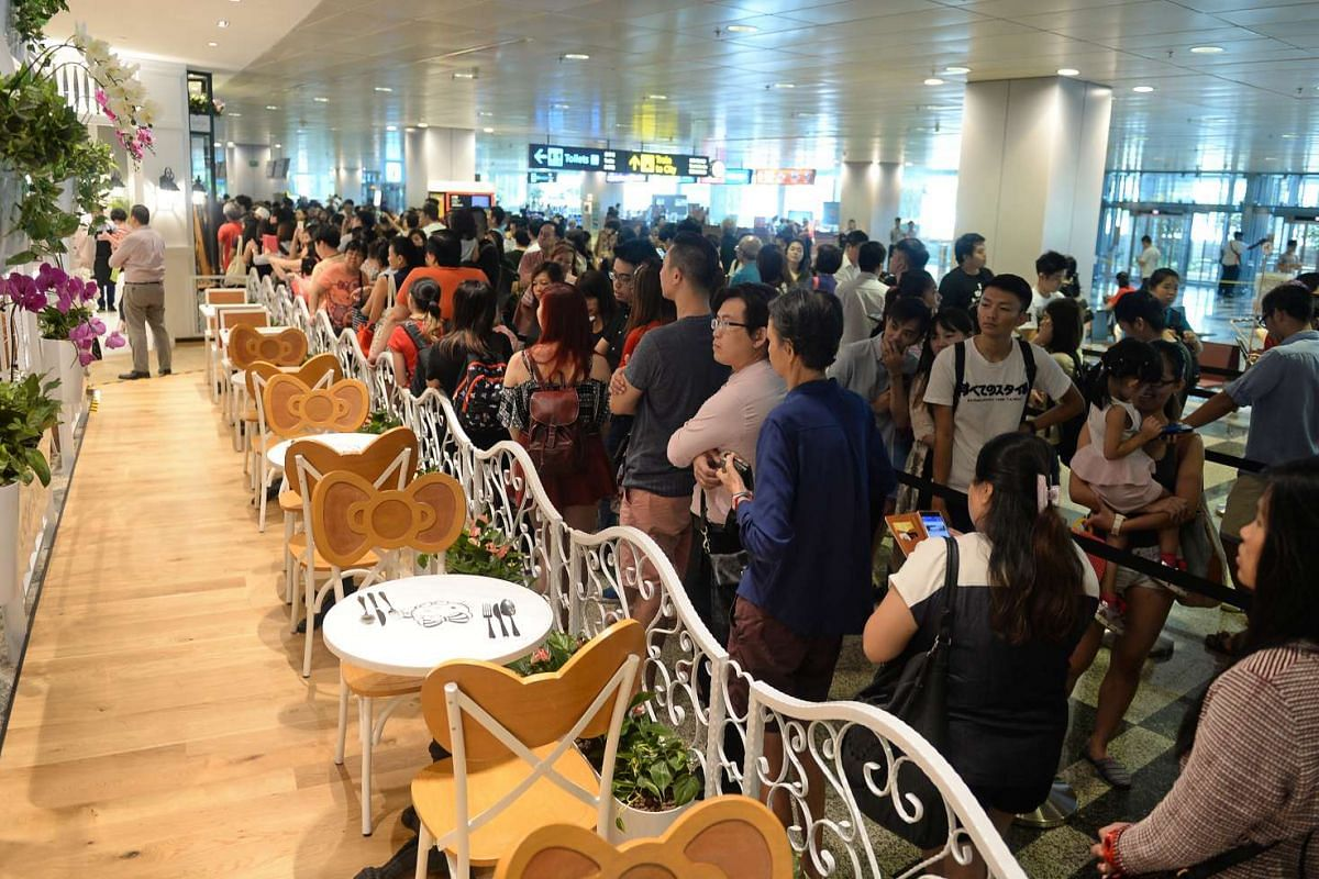 Long queues outside on the opening day of the Hello Kitty themed cafe in Changi Airport Terminal 3's Arrival Hall, on May 12, 2016.