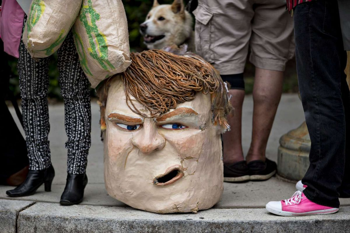 A caricature head of Republican presidential candidate Donald Trump sits on the sidewalk at the Republican National Committee (RNC) headquarters in Washington, on May 12, 2016.