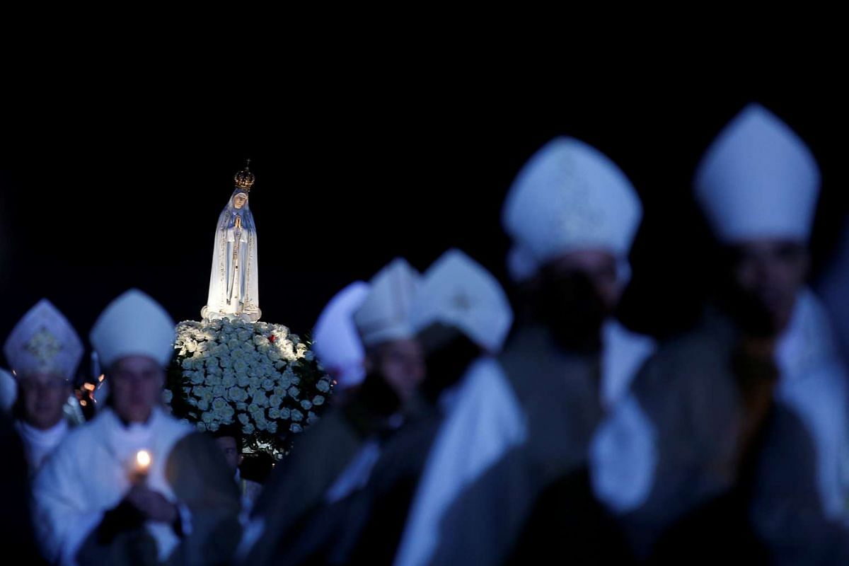 Pilgrims attend the 99th anniversary of the appearance of the Virgin Mary to three shepherd children, at the Catholic shrine of Fatima, Portugal, on May 12, 2016.