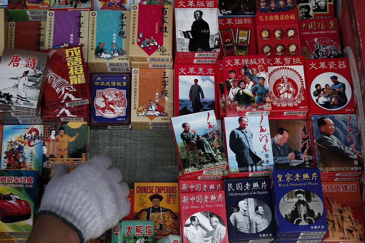 Decks of playing cards with various designs including themes on Mao Zedong and the Cultural Revolution being sold at the Panjiayuan flea market in Beijing, China, on May 8, 2016.