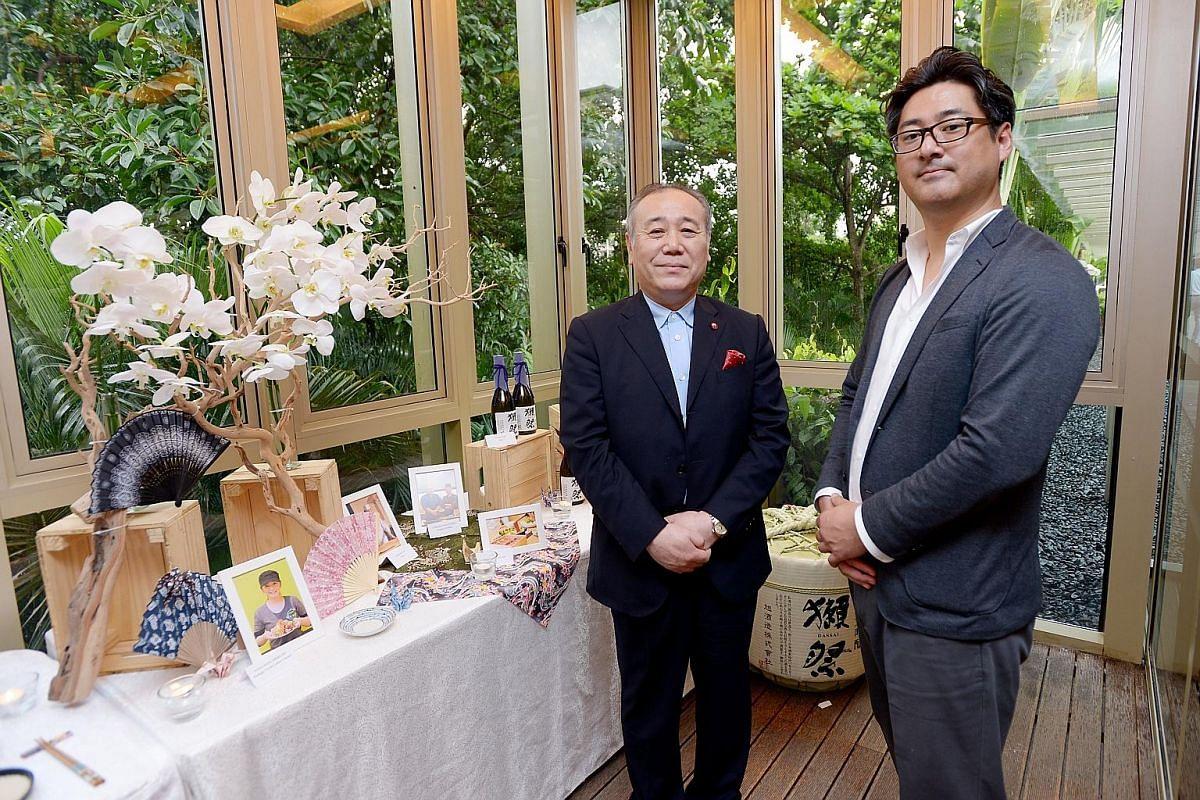 Mr Nobuyuki Ota (far left), chief executive officer of Cool Japan Fund, and Mr Makoto Yoshikawa, Japan Food Town's managing director.