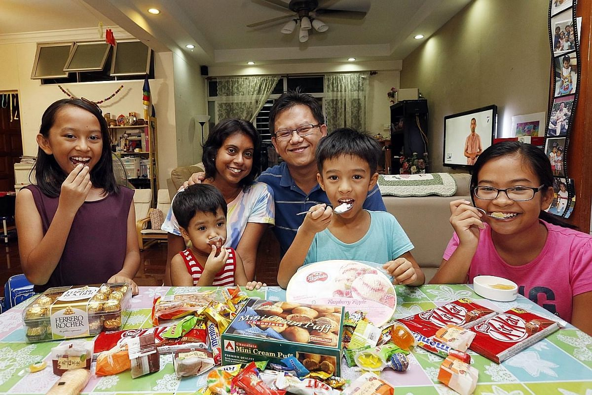 Ms Denise Philip and her husband, Mr Kevin Ng, let their children - (from left) Rianne, 10, Roseanne, four, Kieran, seven, and Su Anne, 12 - have sweet treats on weekends.