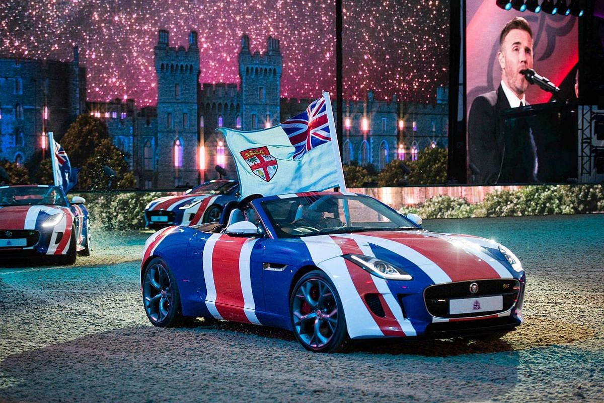 British singer Gary Barlow performs as Jaguar sports cars drive around the arena during the final night of The Queen's 90th Birthday Celebrations at the Royal Windsor Horseshow in the grounds of Windsor Castle on May 15, 2016.