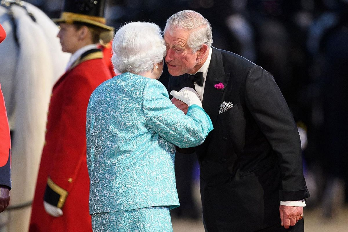 Britain's Queen Elizabeth II is greeted by Britain's Prince Charles, Prince of Wales as she arrives to attend the final night of The Queen's 90th Birthday Celebrations at the Royal Windsor Horseshow in the grounds of Windsor Castle on May 15, 2016.