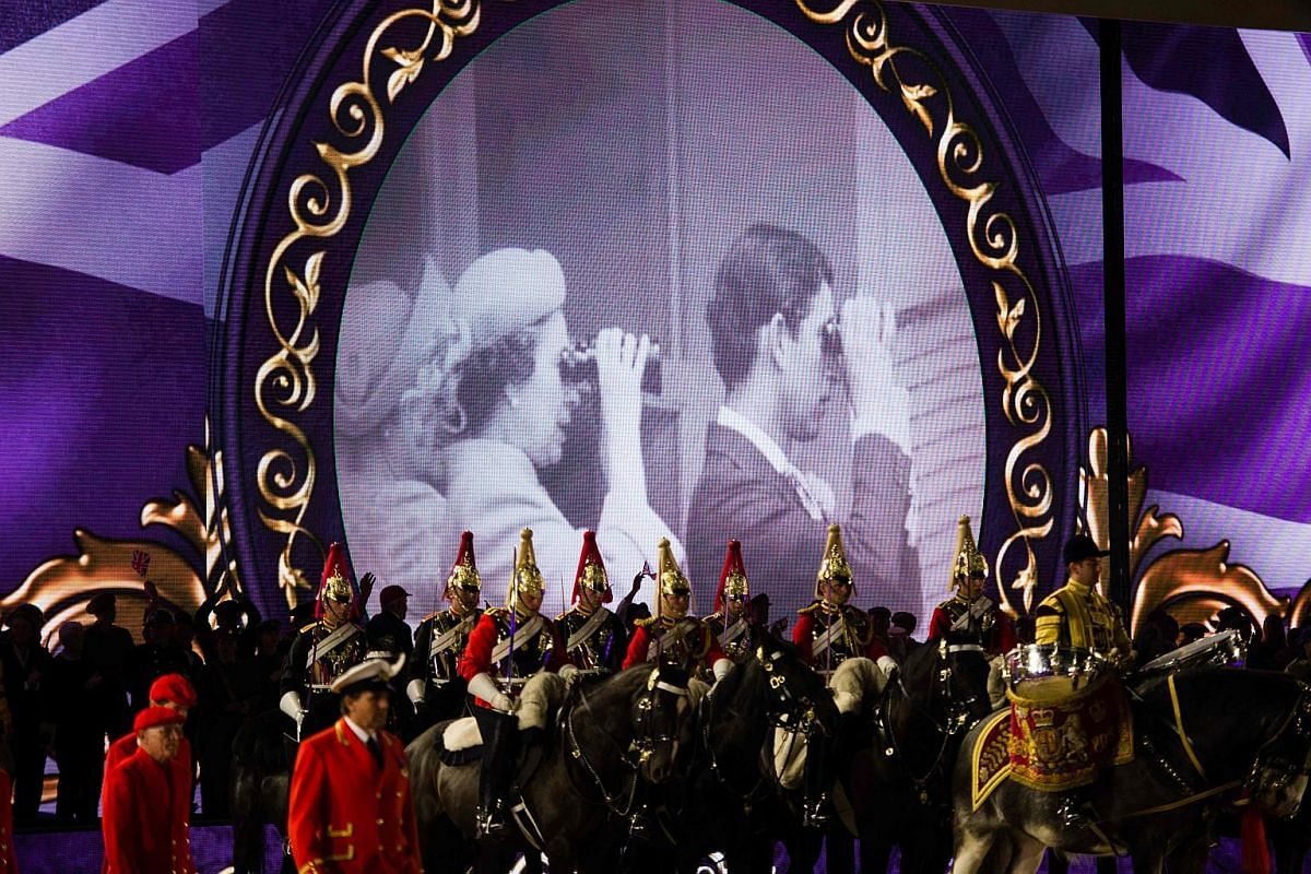 Scenes from the life of Britain's Queen Elizabeth II are shown during the final night of The Queen's 90th Birthday Celebrations at the Royal Windsor Horseshow in the grounds of Windsor Castle on May 15, 2016.