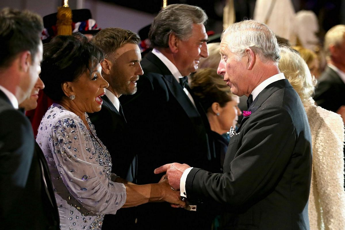 Prince Charles, Prince of Wales greets Dame Shirley Bassey on the final night of Queen Elizabeth II's 90th Birthday Celebrations at Windsor on May 15, 2016.