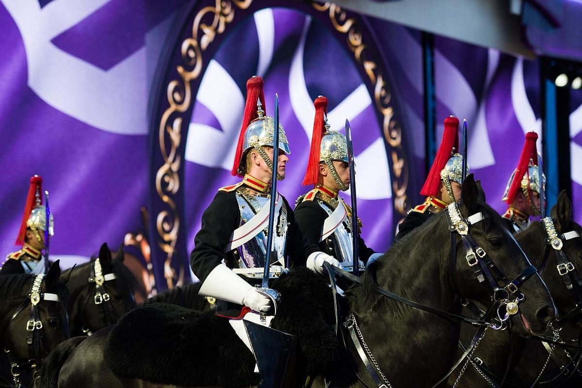 Members of the Household Cavalry perform in the arena during Queen Elizabeth II's 90th Birthday Celebrations at the Royal Windsor Horseshow in the grounds of Windsor Castle on May 15, 2016.