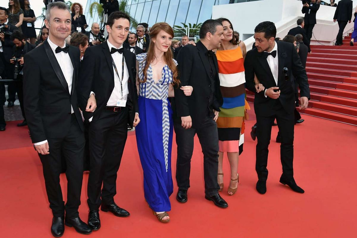 The cast of the film La Caverne (second from left) French actor Arthur Choisnet, French actress Garance Rivoal, French cartoonist and director Joann Sfar, French actress Sarah Jane Sauvregrain and French actor Quentin Faure pose on the red carpet.