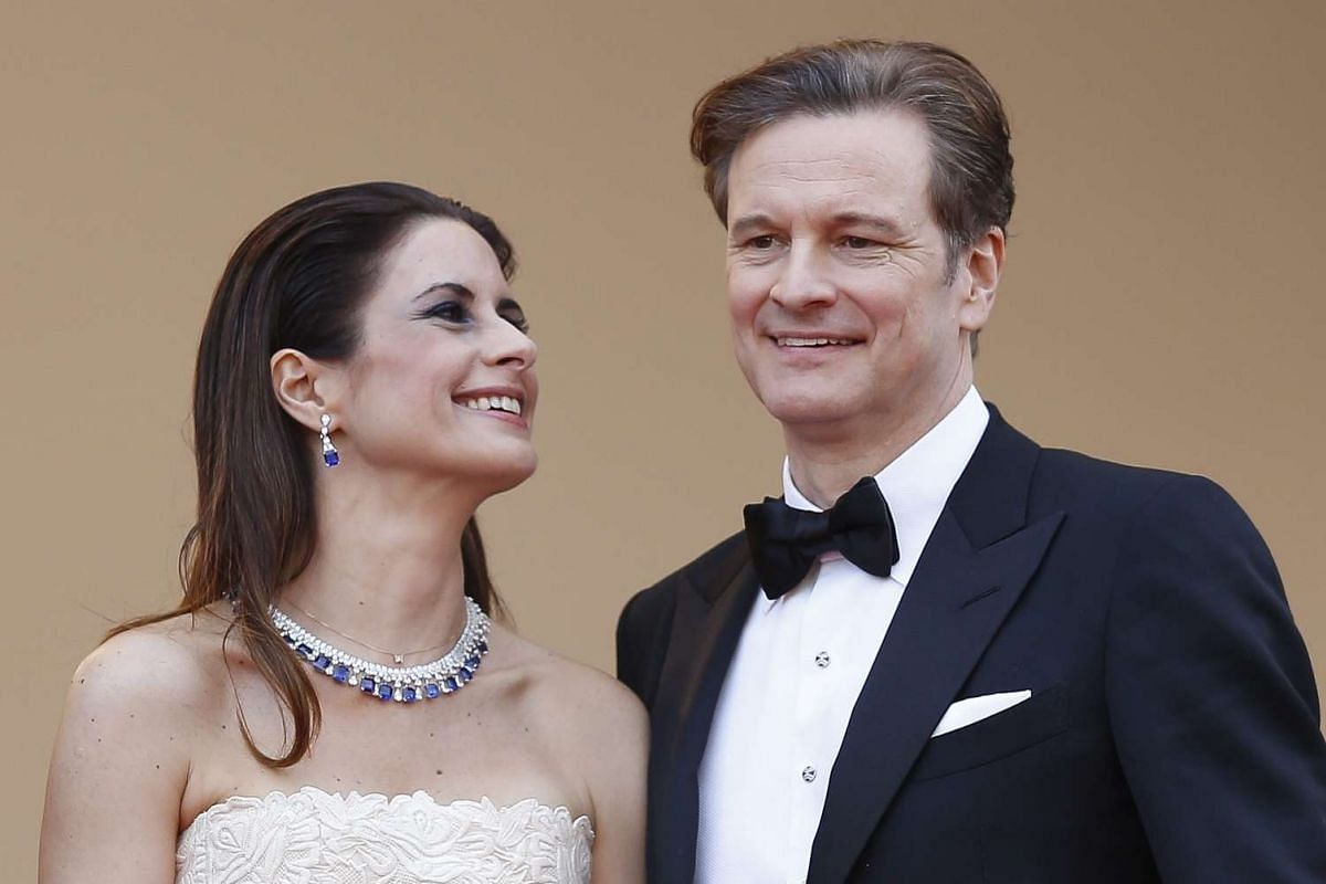 British actor Colin Firth (right) and his wife Livia Giuggioli arrive for the screening of Loving.