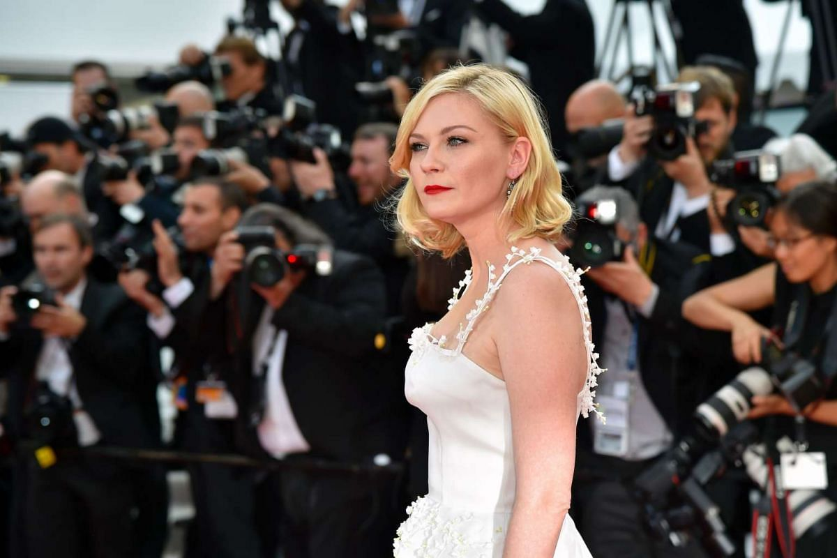 Kirsten Dunst poses on the red carpet as she arrives on May 16, 2016 for the screening of the film Loving.