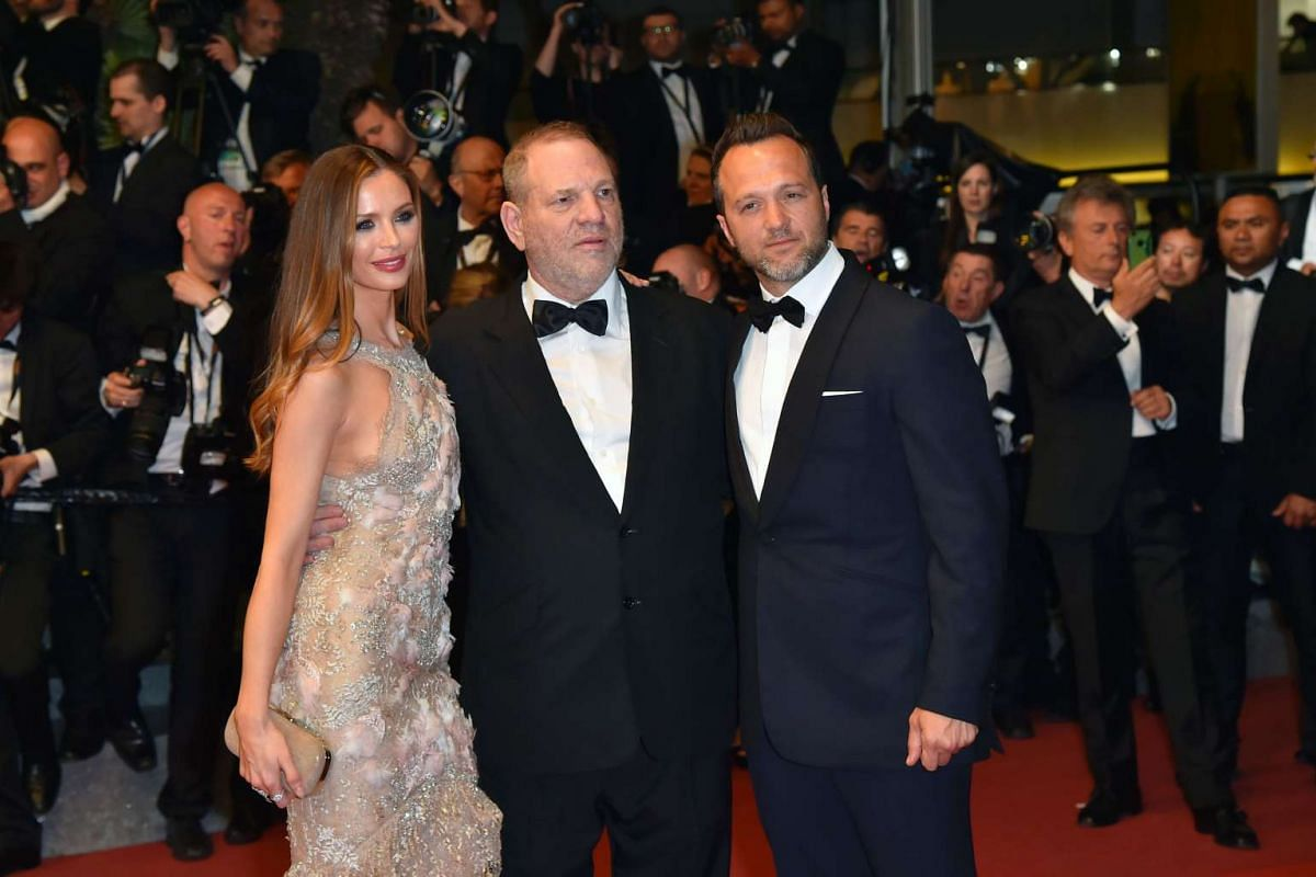 US producer Harvey Weinstein (centre), with his wife actress Georgina Chapman and producer Jay Weisleder pose on the red carpet.