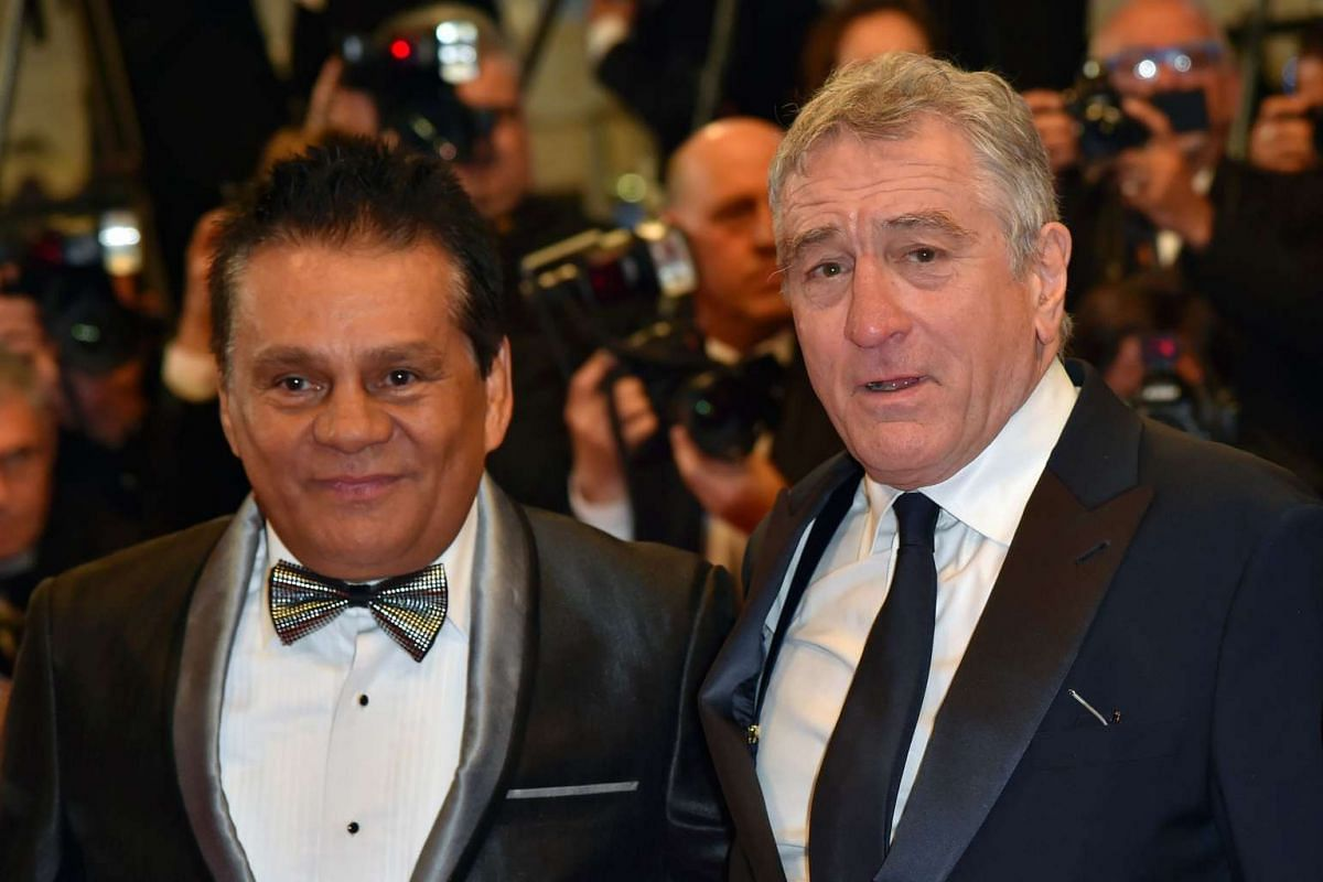 Panamanian boxer Roberto Duran (left) and US actor Robert de Niro arrive for the screening of the film Hands Of Stone.