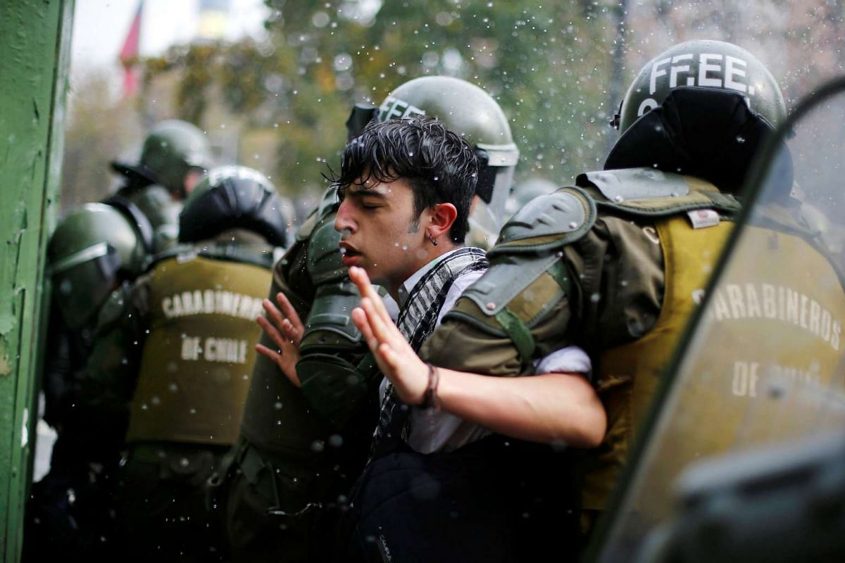 "A demonstrator is detained during a ""Reflexive strike of students"" called by the Chilean student federations to request better and more changes in the education system in Santiago, Chile, May 17, 2016. PHOTO: REUTERS"