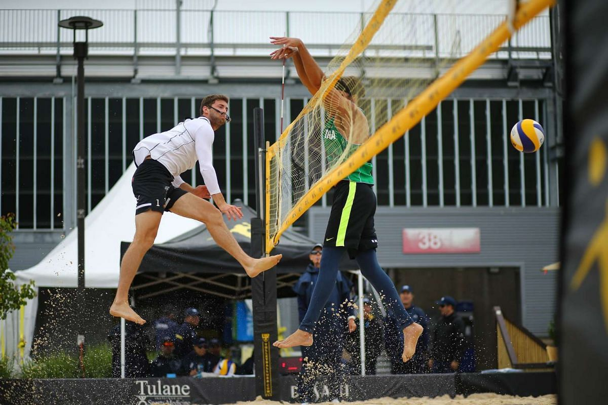 Hendrik Mol of Norway sends the ball over the net against Fernando Magalhaes of Brazil during day 1 of the 2016 AVP Cincinnati Open on May 17, 2016 at the Lindner Family Tennis Center in Cincinnati, Ohio. PHOTO: GETTY IMAGES/AFP