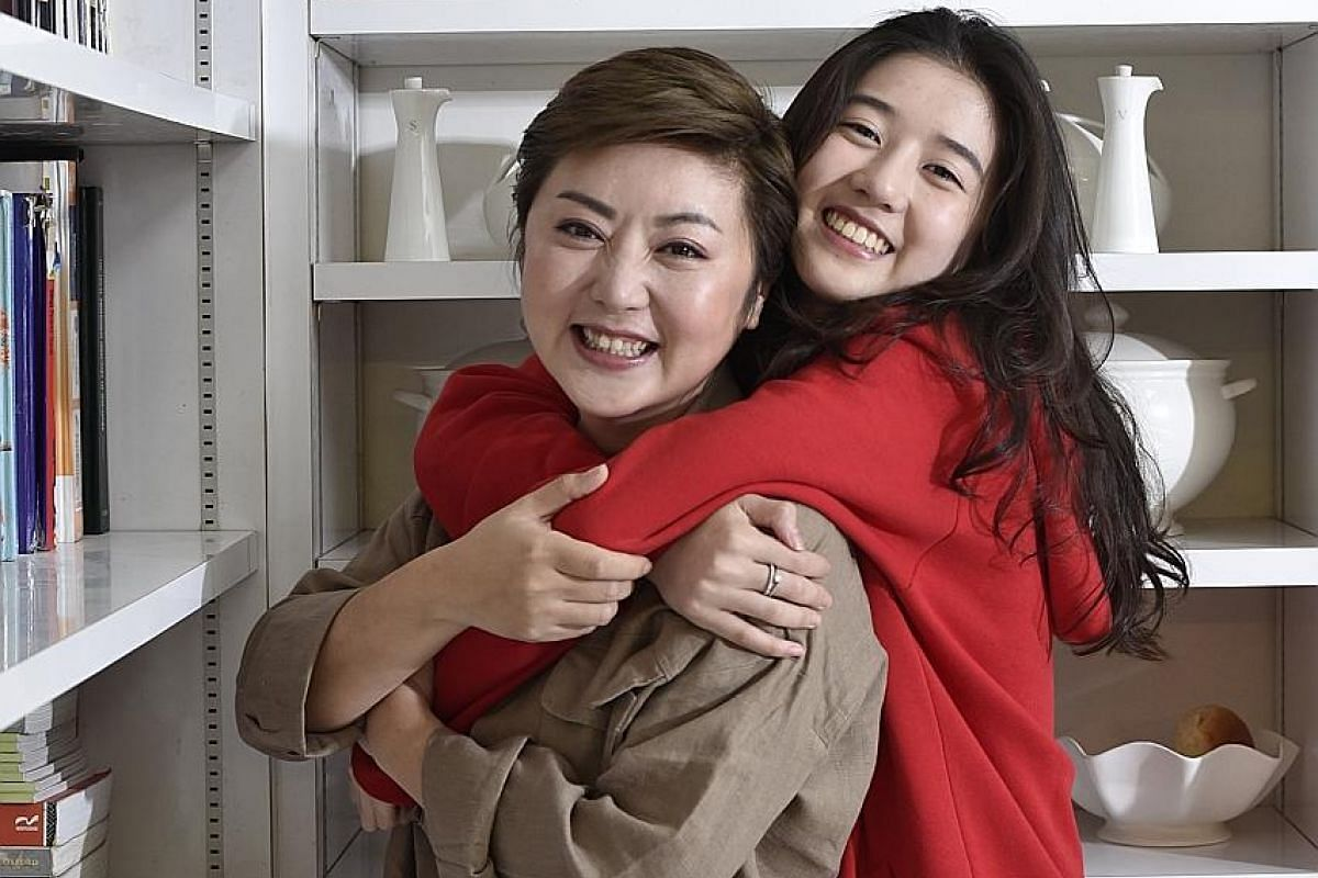 Singapore host Quan Yi Fong (above, with her daughter Eleanor Lee) and in the new movie, Young & Fabulous (with co-star Aloysius Pang).