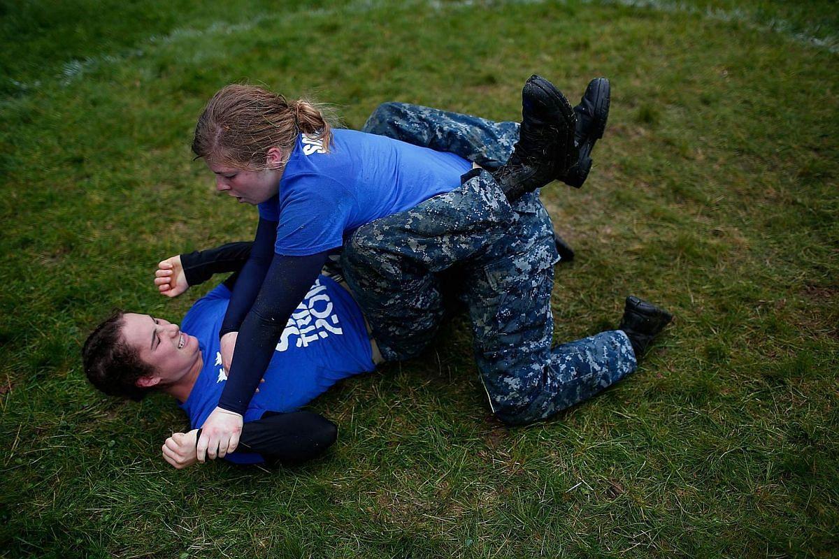"""Female Naval Academy plebes engaging in """"ground fighting"""" combat during the annual Sea Trials on May 17, 2016."""