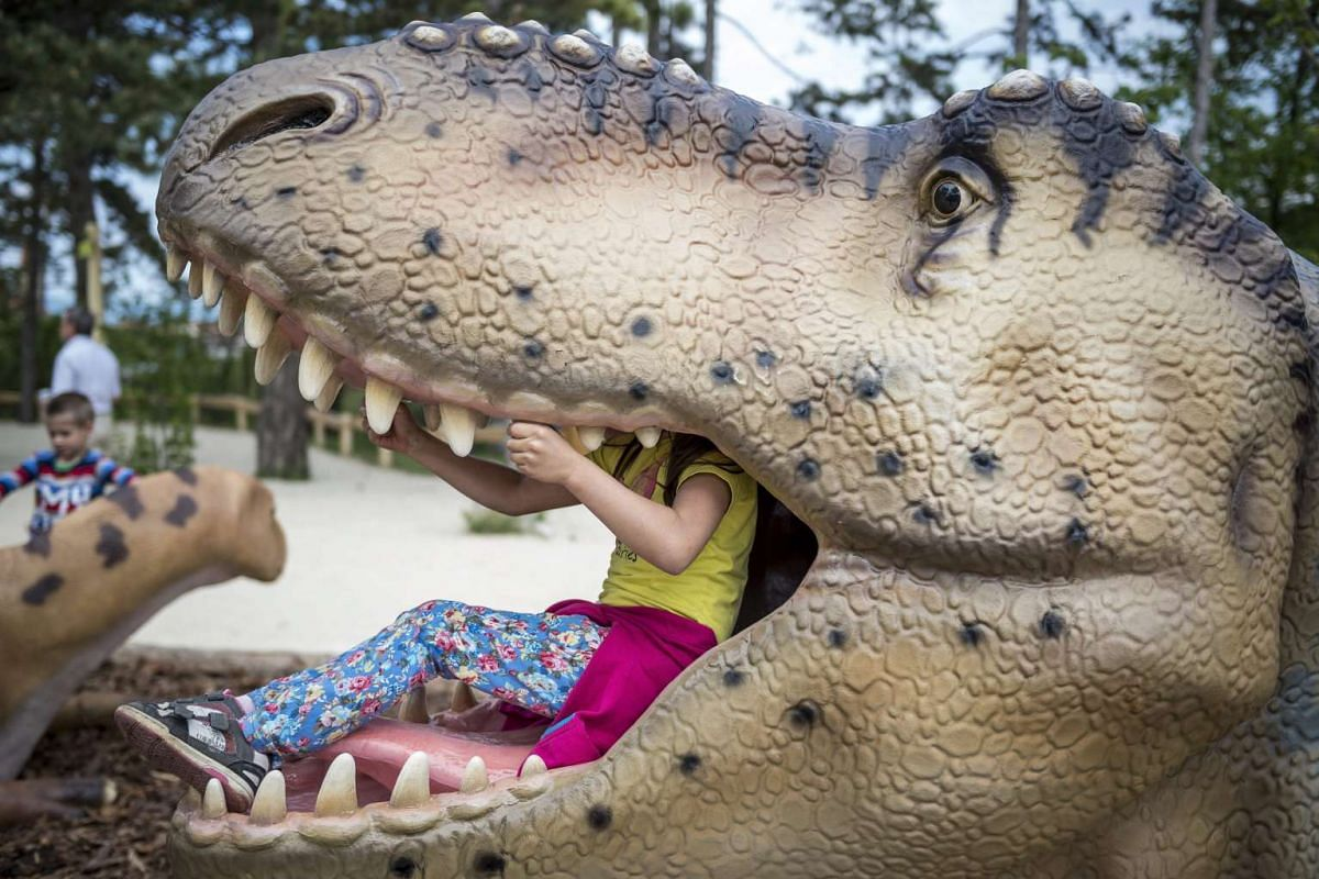 Children enjoy the playground in a park of prehistoric animals following its opening on the premises of the Veszprem Zoo in Veszprem, 108 kms southwest of Budapest, Hungary, May 18, 2016. There are 30 models of various types of dinosaurs, among them
