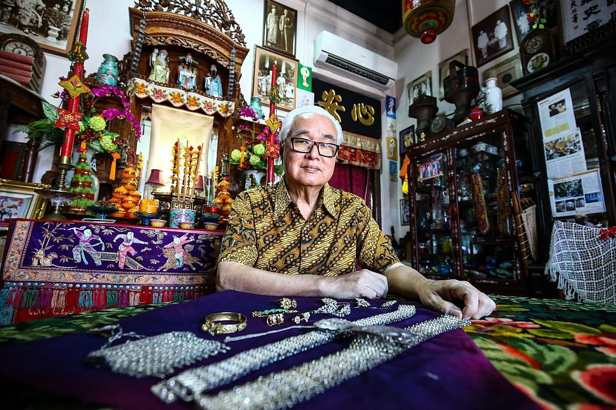 A 40-year-long labour of love helped Mr Peter Wee (above) amass a huge collection of Peranakan items including some pieces that hark back to the 1920s and 1930s. (Above) This gold bracelet with intricate carvings and bells was worn by Mr Peter Wee as