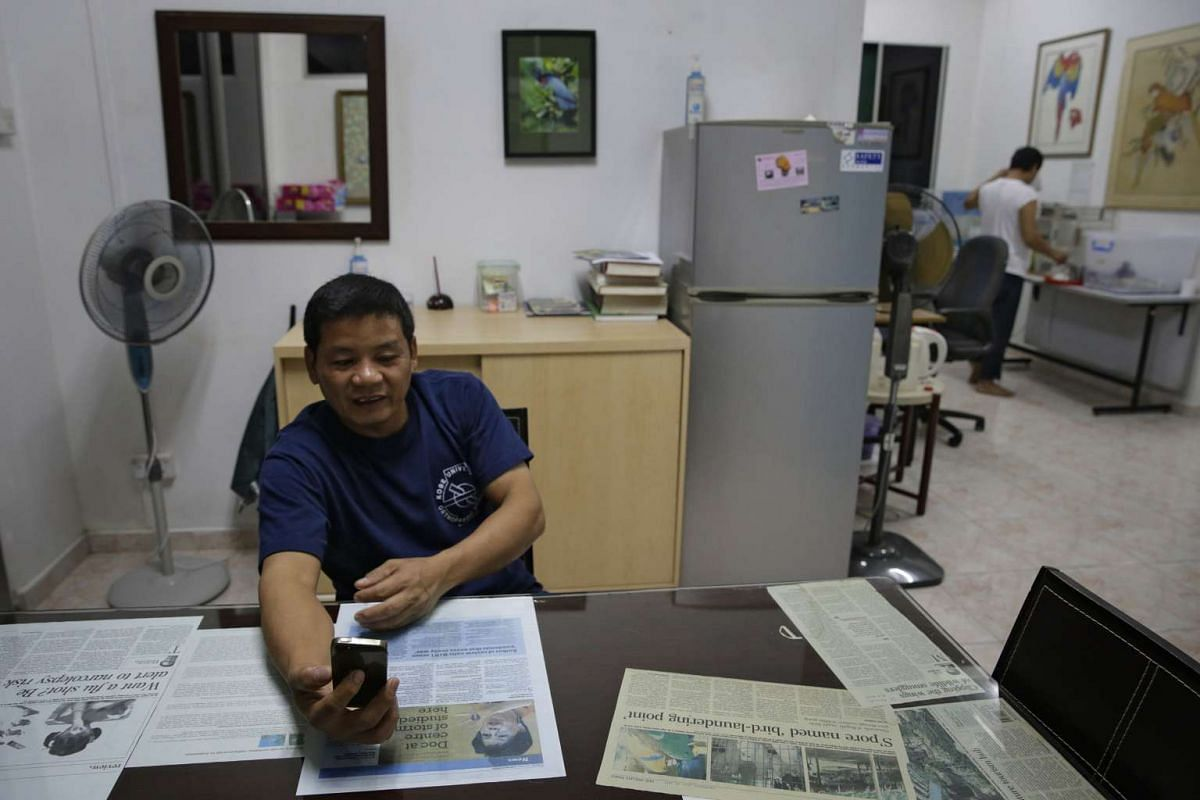 Mr Rosendo Jacildo talks to his family in Luzon, the Philippines, over a video chat in his office in Mandai Birds Sanctuary on May 16, 2016.