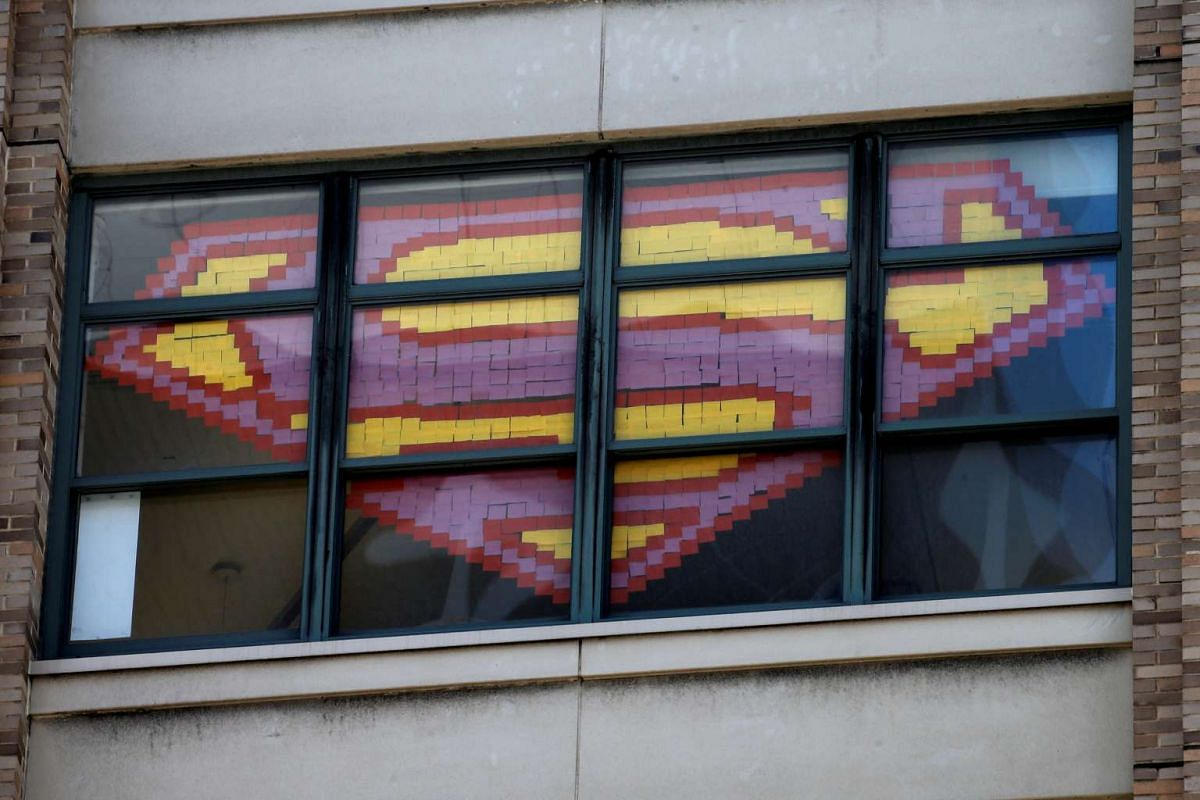 An image of the Superman Logo created with Post-it notes is seen in windows at 200 Hudson street in lower Manhattan, New York.