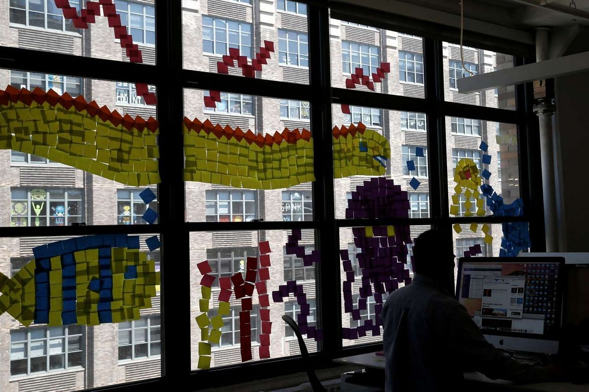 Images created with Post-it notes are seen in windows from the Havas Worldwide Media offices at 200 Hudson street in lower Manhattan, New York.