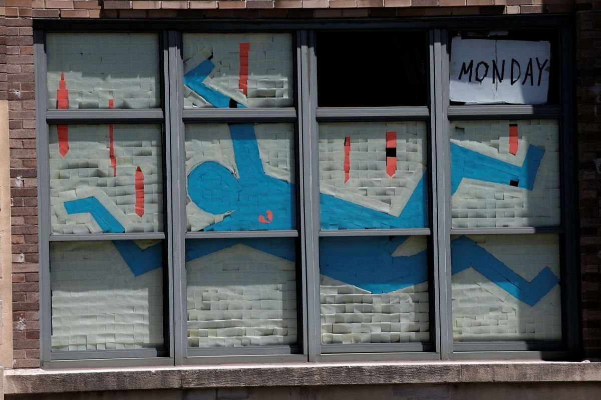 An image created with Post-it notes is seen in windows at 75 Varick street in lower Manhattan, New York.