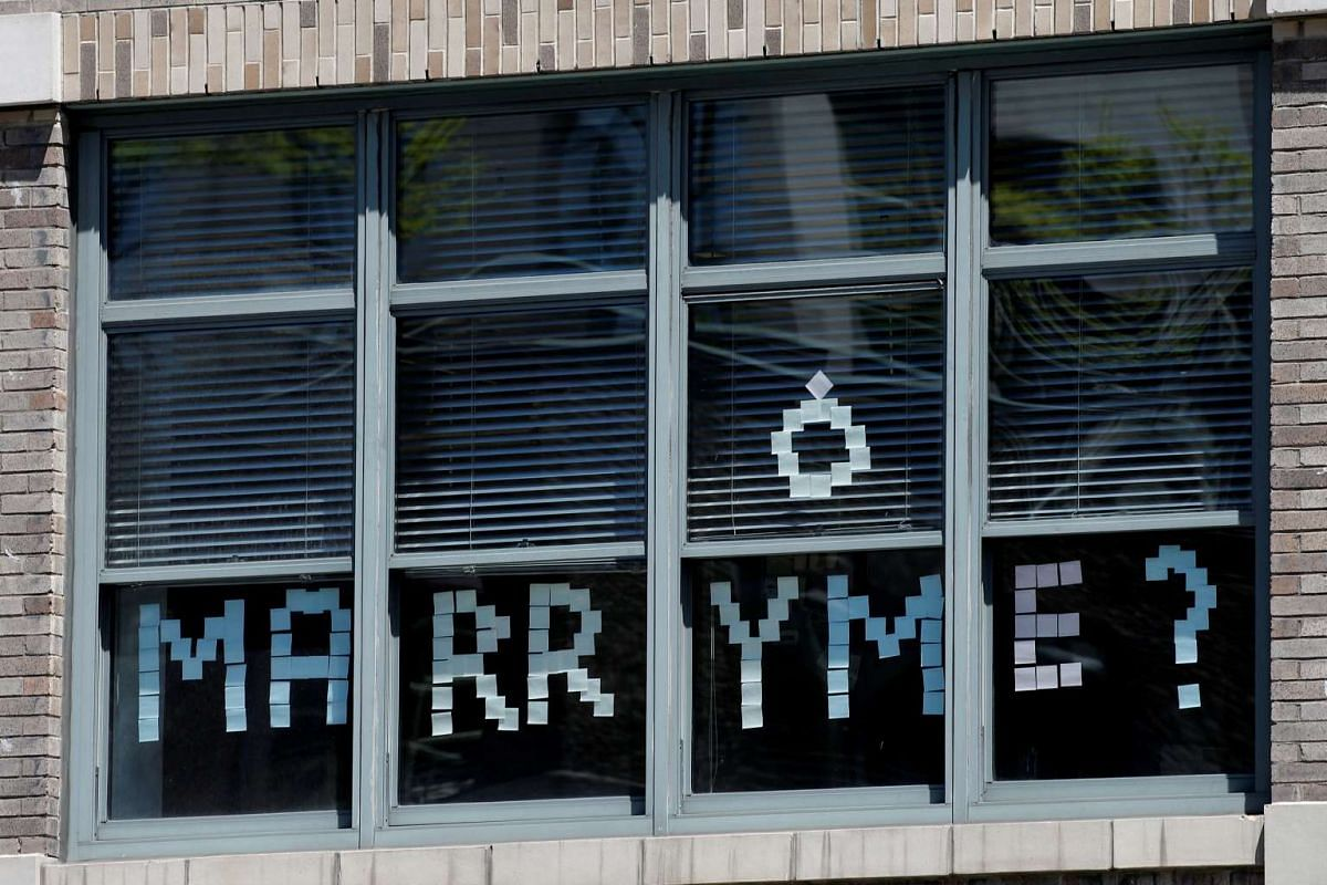 A message created with Post-it notes are seen in windows of 200 Hudson street in lower Manhattan, New York.