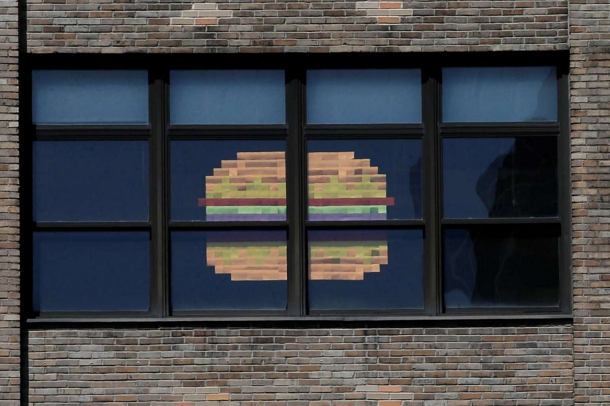 An image of a hamburger created with Post-it notes is seen in windows at 75 Varick street in lower Manhattan, New York.