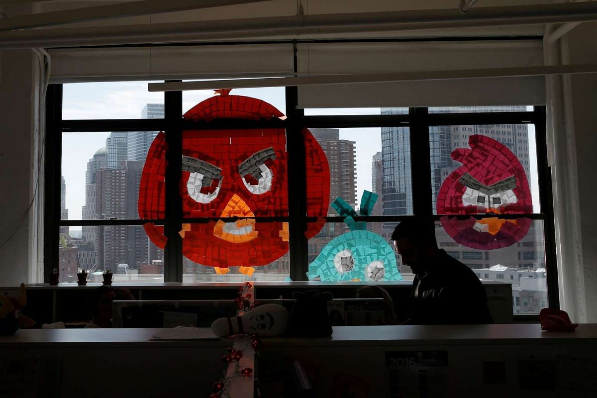 Images of Angry Birds created with Post-it notes are seen on a window created with Post-it notes at the Horizon Media offices at 75 Varick Street in lower Manhattan, New York.