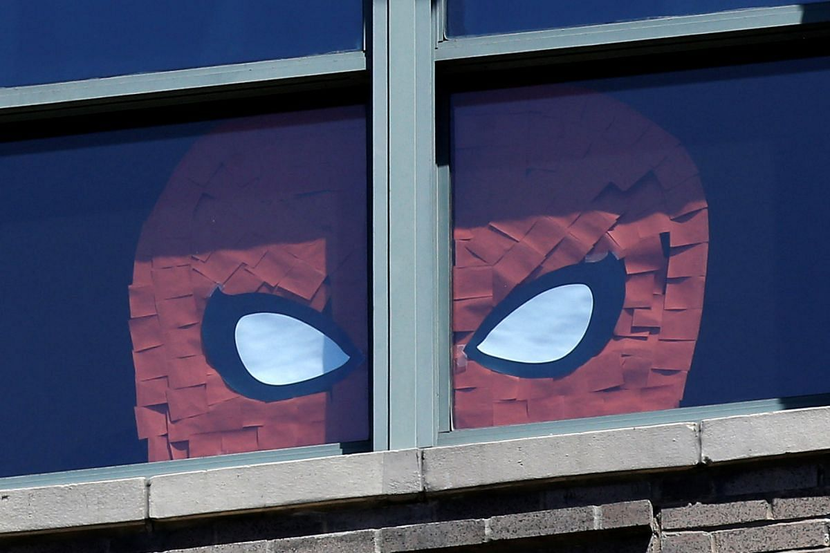 An image of Spider Man created with Post-it notes is seen in windows at 200 Hudson street in lower Manhattan, New York.