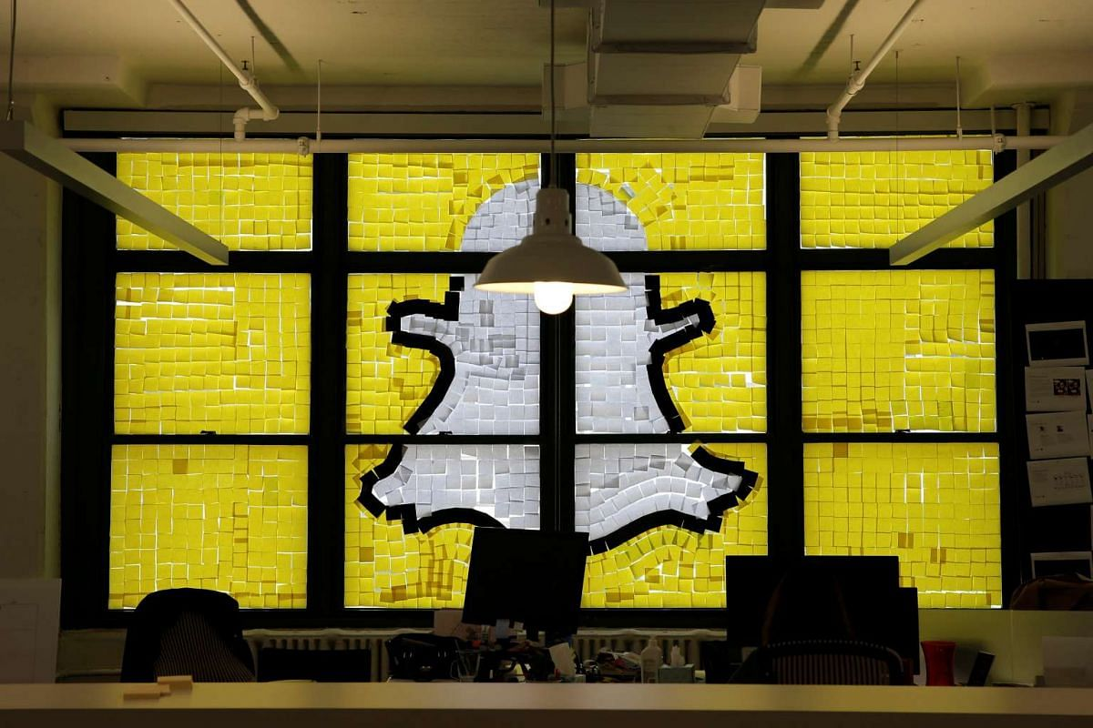 An image of the Snapchat logo created with Post-it notes is seen in the windows of Havas Worldwide at 200 Hudson Street in lower Manhattan, New York.