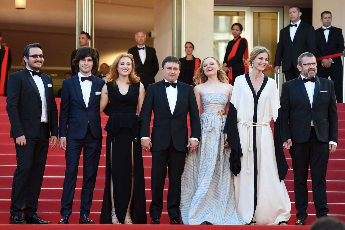 (From second, left) Romanian actor Rares Andrici, Romanian actress Malina Manovici, Romanian director Cristian Mungiu, Romanian actress Maria Dragus, Romanian actress Lia Bugnar and Romanian actor Adrian Titieni posing as they arrive on May 19, 2016,