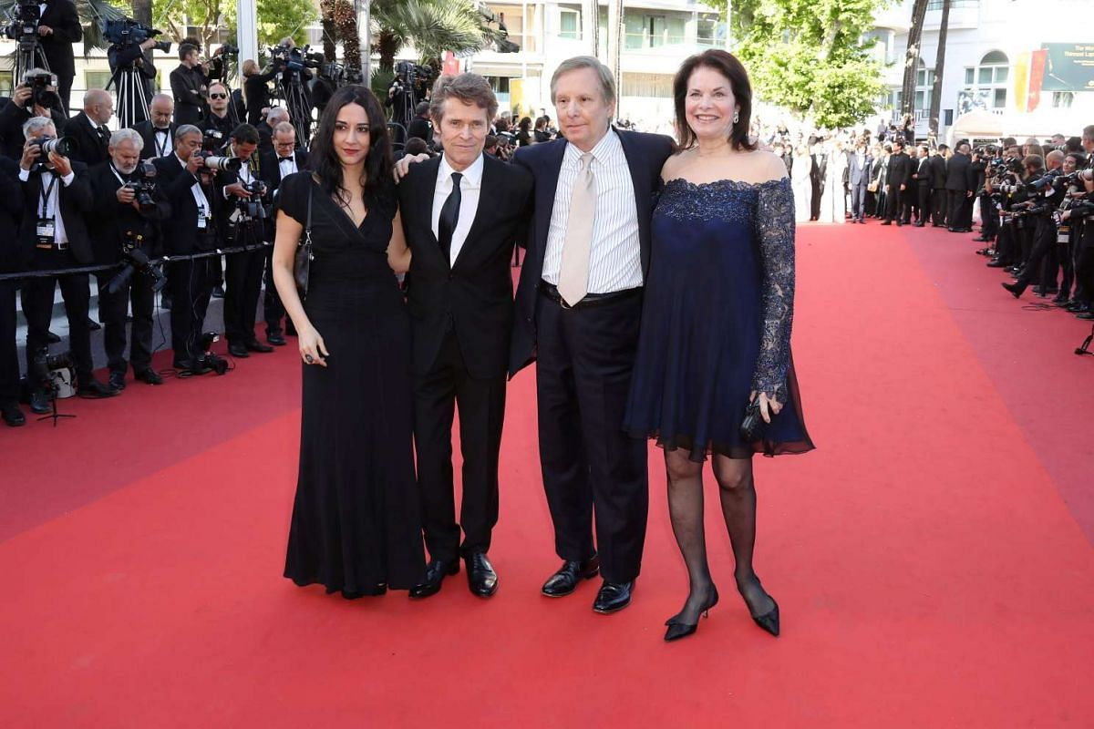 US actor Willem Dafoe (second from left), his wife Giada Colagrande (left), US director William Friedkin (second from right) and his wife Sherry Lansing arriving on May 19, 2016 for the screening of the film Graduation (Bacalaureat) at the 69th Canne